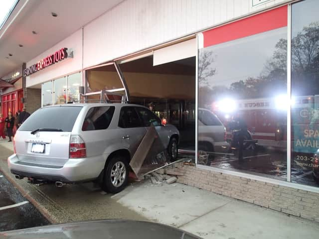 An SUV crashed into a Post Road East storefront.