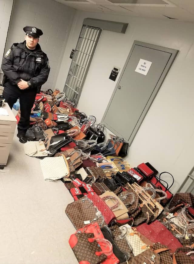 Port Authority Police Officer Christopher Roncancio and the knockoff haul.