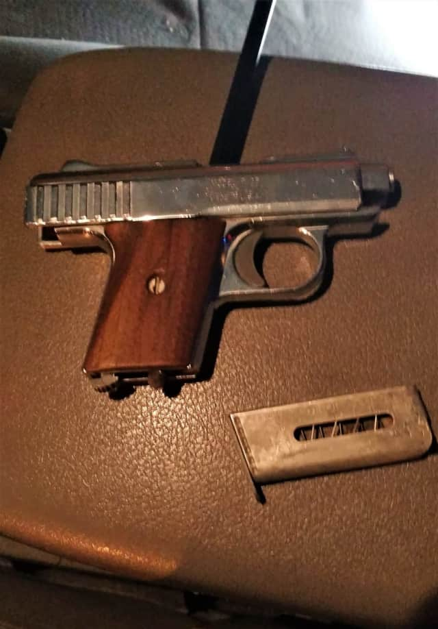 Port Authority police said they found the .25-caliber semi-automatic pistol in the glove compartment and the knife in the rear of the SUV.