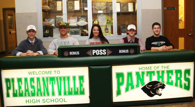 Five Pleasantville High School athletes who committed to playing a sport in college sign letters of intent.
