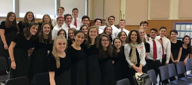 The Pelham Memorial High Chamber Chorus and director Maria Abeshouse