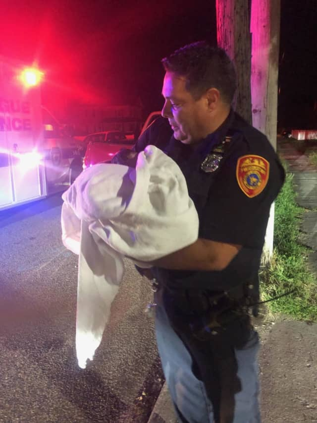 Officer Robert Burgos helped deliver a baby girl in Patchogue.