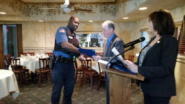 Ramapo Police Officer Wayne Mitchell accepts congratulations from County Executive Ed Day at the Stop-DWI Awards Luncheon.