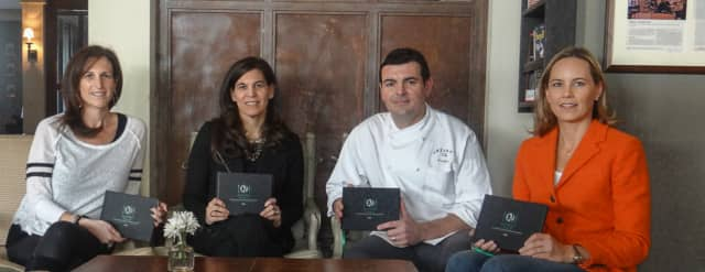 From left, Mica DeSantis, Aline Weiller, Artisan's Executive Chef Frederic Kieffer and Elizabeth Menke gear up for the launch party for Entrée Nous, LLC and its first restaurant guide (Fairfield County edition).