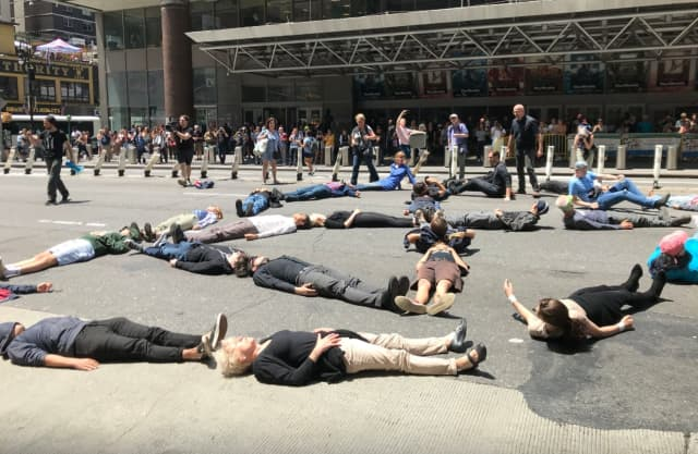 Protestors laid down across 8th Avenue between the Port Authority bus terminal and New York Times building.
