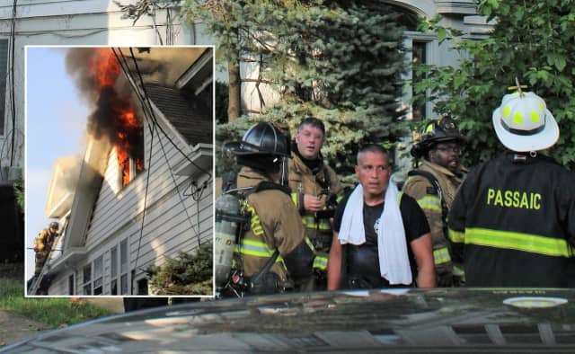 Firefighters battled heat and flames at the Howard Avenue fire in Passaic.