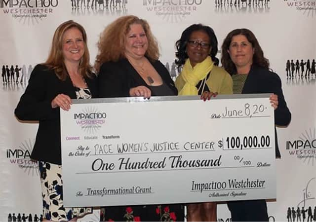 Members of Pace Women's Justice Center receive their grant from Impact100 Westchester.