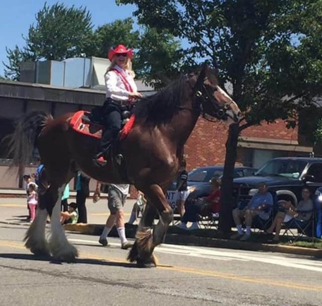 Stuntwoman and Elmwood Park native Diane Peterson rides a horse in the borough's Centennial Parade on Sunday.