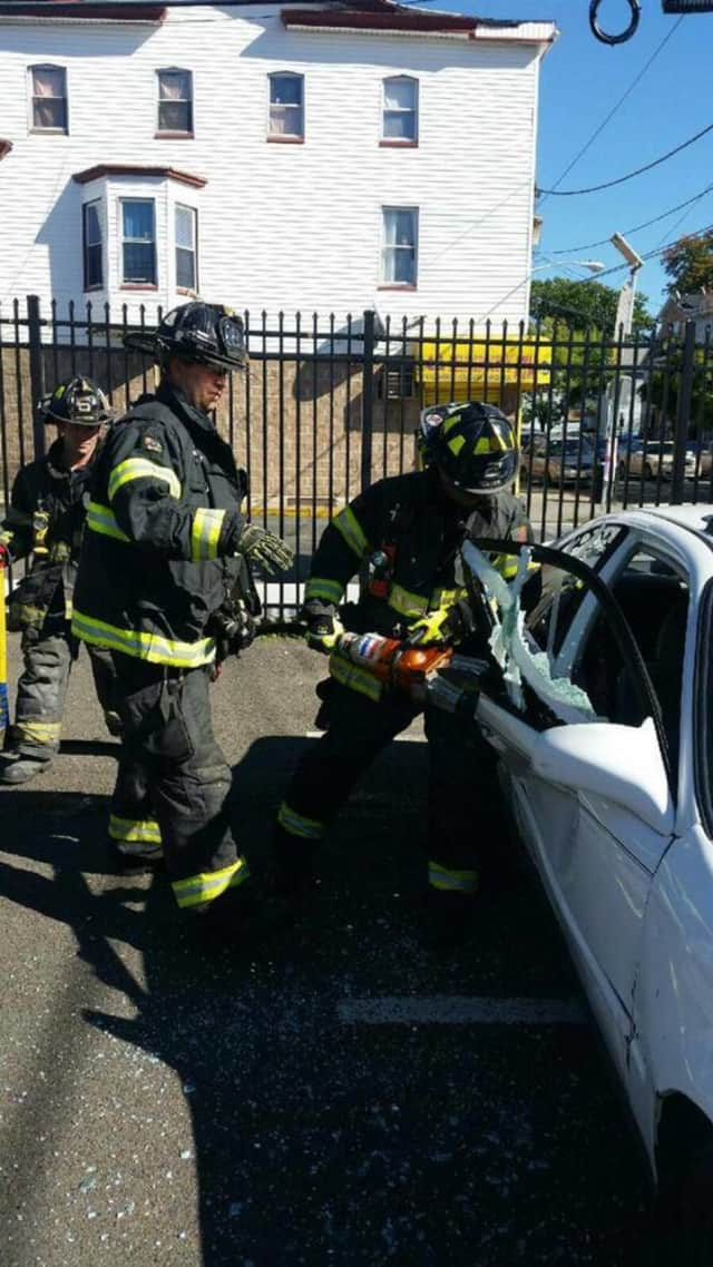 Two Paterson firemen treating a patient as EMTs.
