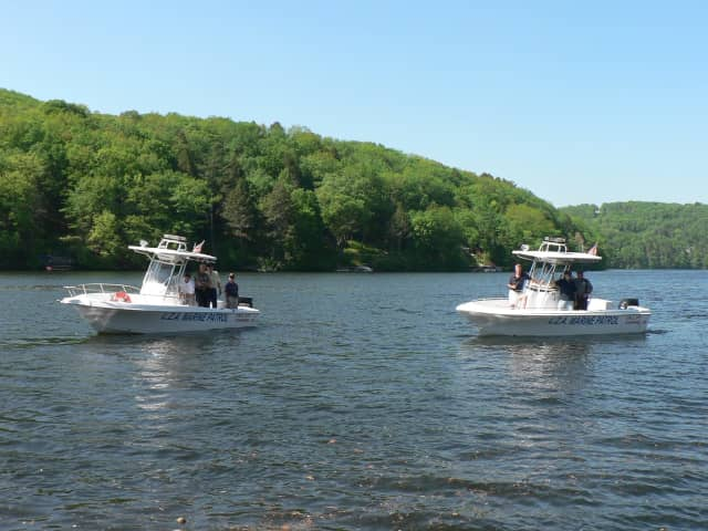 Two police boats patrol Lake Zoar. The growth of algae in the water depends on the summer weather.