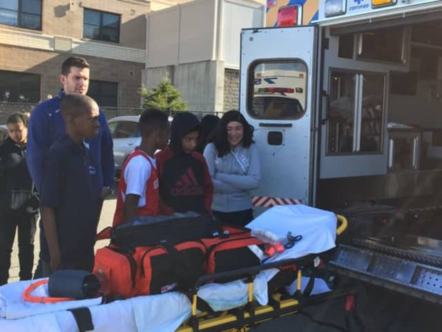 Peekskill EMS workers give Peekskill Middle School students a demonstration on the middle-schoolers' recent career day visit.