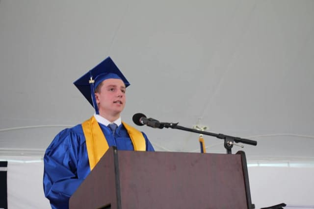 "Pelham High School senior Matthew O'Neil reads his speech, titled ""Liberating, Exciting and Strange,"" at last month's graduation ceremony."