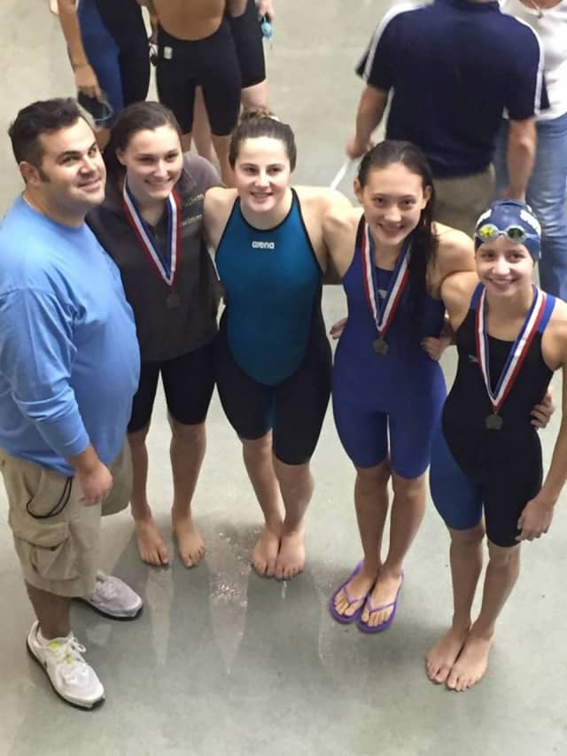 The 200 meter relay team after taking Section One title and breaking the current record.