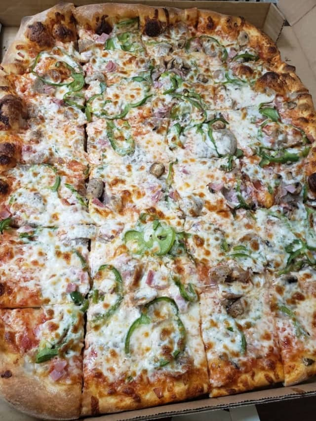 A pie with peppers, mushrooms, sausage and ham from Peppo's Pizza in Agawam.