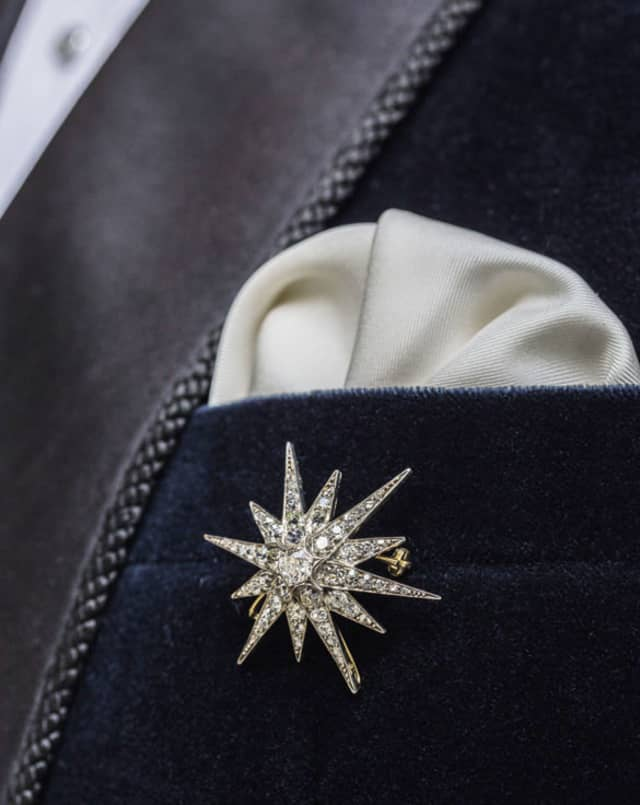 A Victorian diamond 12-ray star brooch from Bentley & Skinner, centered on a 0.65-carat old brilliant-cut diamond (circa 1870). Tailoring by Henry Poole & Co.