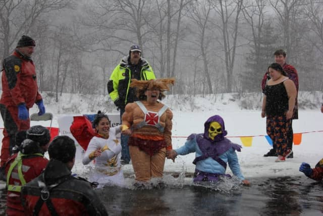 Superheroes take the plunge to help fight Alzheimer's.