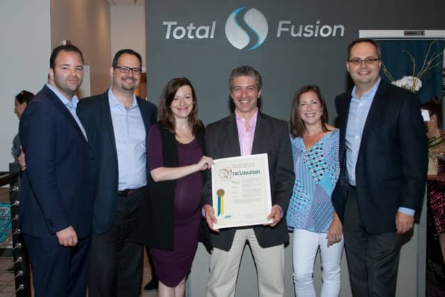 Mitchell Slavuter, Richard Bayer, Sasha Bayer, Dr. Dima Teitelman, Stacy Bayer, Alex Bayer hold proclamation at grand opening event of TotalFusion in Harrison.