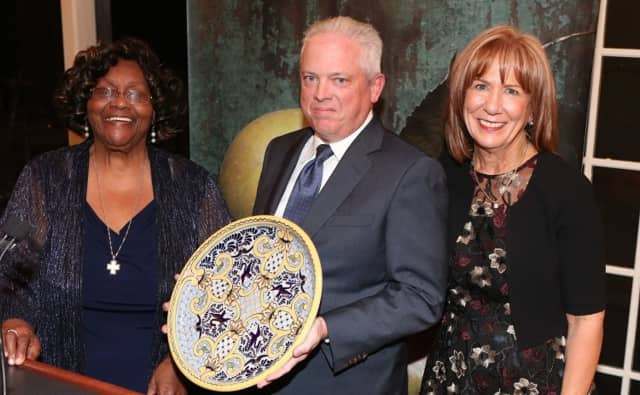 Rev. Jeannette Phillips, HRHCare founder, and Anne Kauffman Nolon, HRHCare president and CEO, presenting an award to ArchCare President and CEO Scott La Rue.
