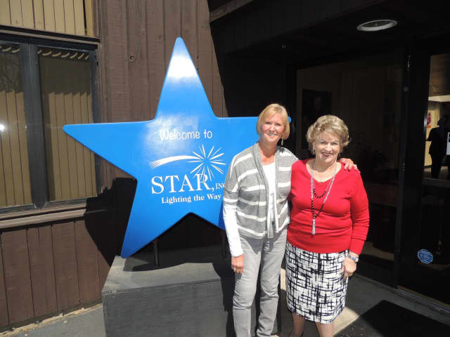 Lois Marasco of Norwalk (right ) and Linda Snell of Fairfield both celebrate 25 years of service with local agency, STAR Inc., Lighting the Way