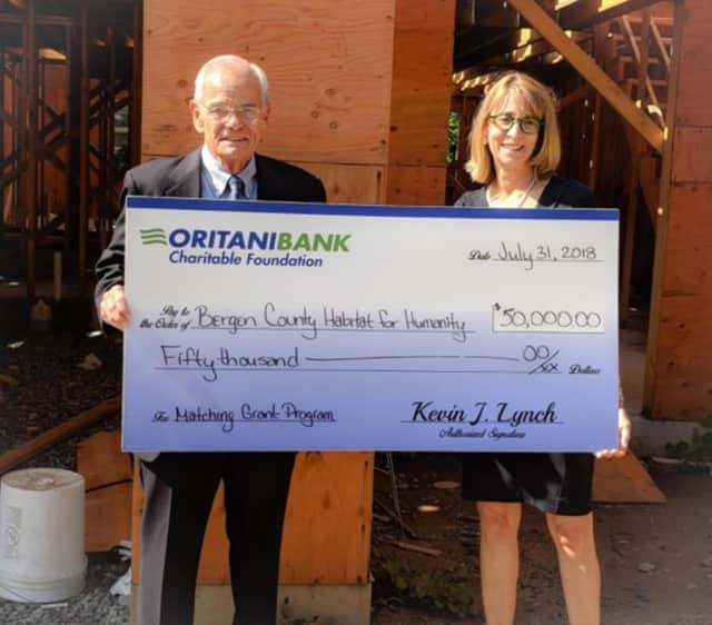 Kevin J. Lynch, president of the OritaniBank Charitable Foundation and chairman, president and CEO of Oritani Bank and Jacey Raimondo, executive director of Habitat for Humanity of Bergen County.