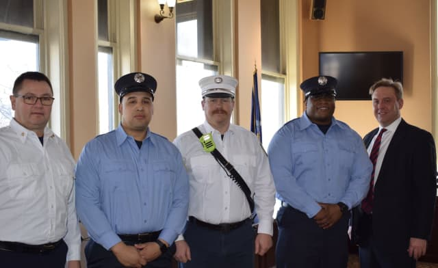 The new recruits and officers promoted.