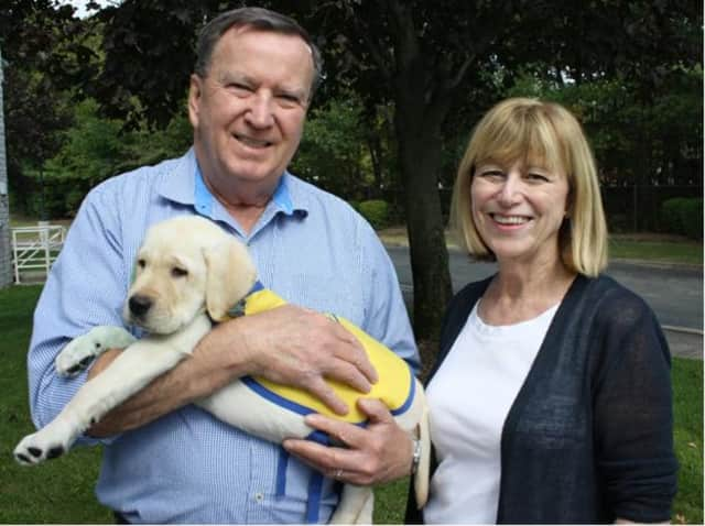 Robert and Ann Benson of New Milford pose with their dog, Hannon.