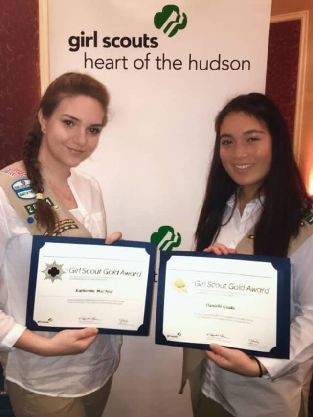 Danielle Guida and Katie MacNeil holding their award certificates at the Girl Scouts Heart of the Hudson Gold Award ceremony.