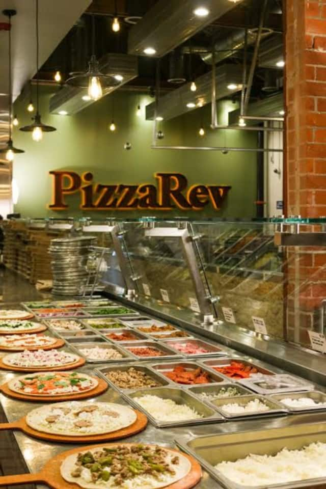 Customers get to choose the fixings for their own pizzas at PizzaRev.