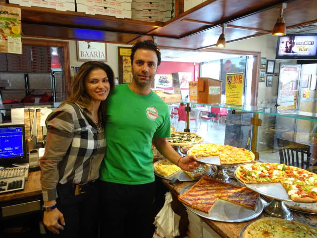 Adisa Feratovic, left, helps her fiancé, Gaetano Buttitta, right, run Pizza Mania in Garfield.