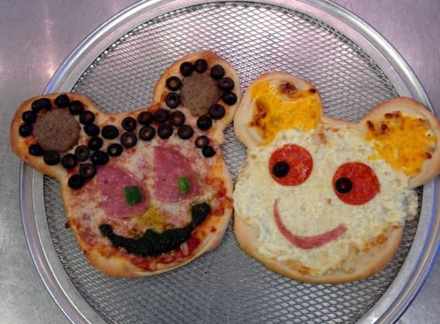 Mickey and Minnie Mouse shaped pies, with their pepperoni eyes and meatball ears, are part of the fun at Pizza One.