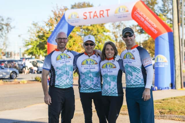Left  to right: Raveis Co-President Chris Raveis, Founder/ Chairman and CEO Bill Raveis, William Raveis Charitable Fund Managing Director Meghan Raveis, Co-President Ryan Raveis at a William Raveis Ride + Walk event.