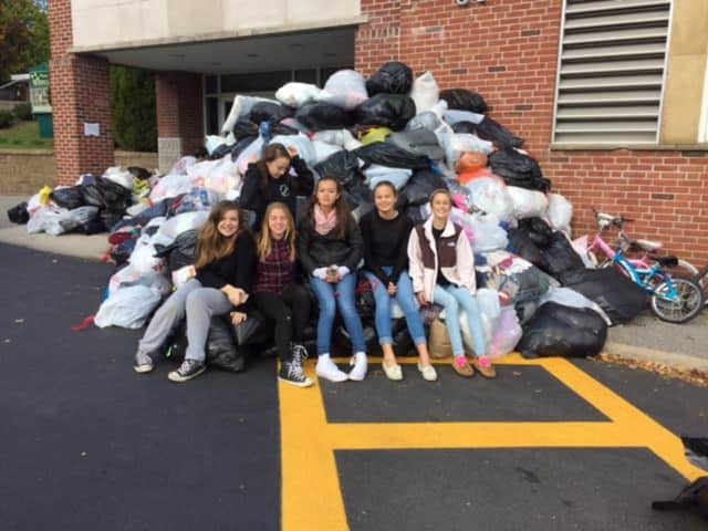 Eighth-grade volunteers helped make the Pleasantville PTA's used-clothing drive a success