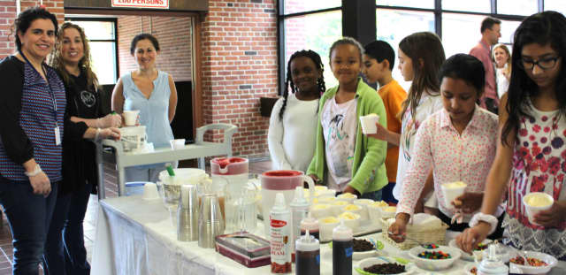 Pocantico Hills students enjoy an ice cream party for donating to the needy.