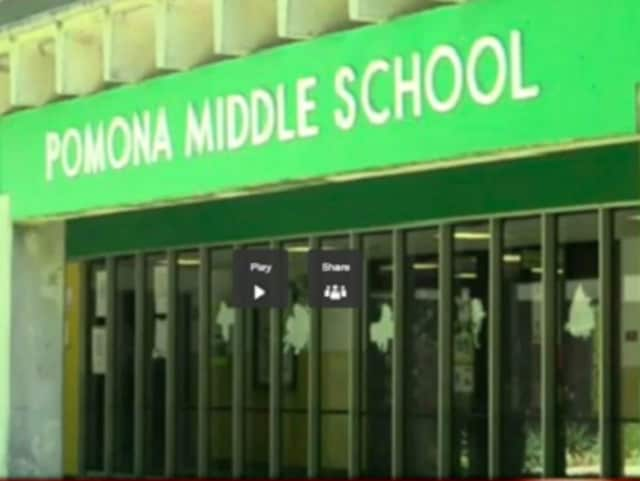 Police are investigating what led to the display of a racist message outside Pomona Middle School Saturday.