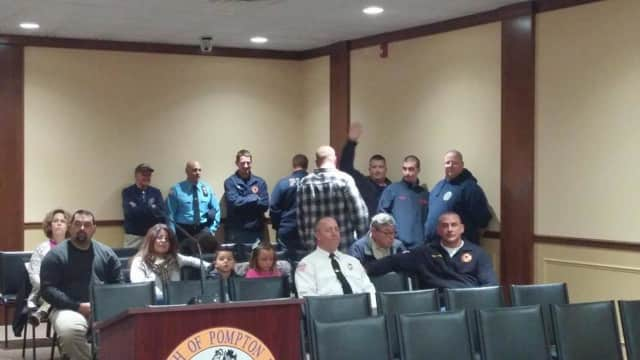 Solis, sitting on the far left next to his family, was sworn in on Wednesday to the Pompton Lakes Voulteer Fire Department.
