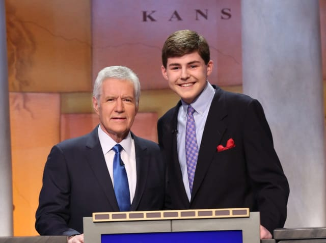 Porter Bowman, a junior at St. Luke's School in New Canaan, a competitor in the 2016 'Jeopardy Teen Tournament,' is with the show's host, Alex Trebek.