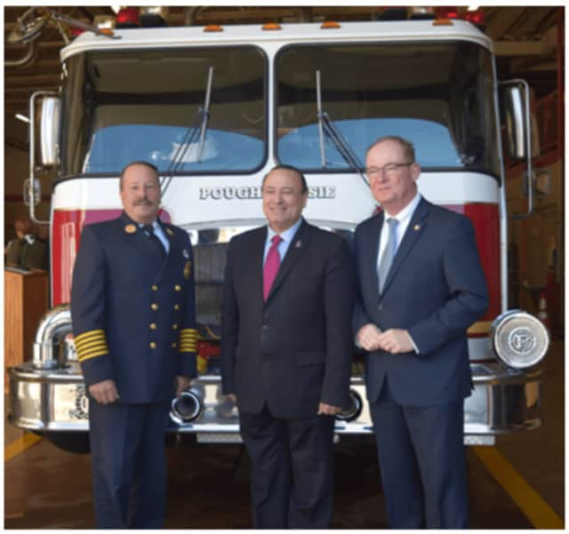 The city of Poughkeepsie has been awarded a $1 million grant to replace a 20-year-old firetruck and other apparatus. From left are Fire Chief Mark Johnson, state Assemblyman Frank Skartados and Mayor Rob Rolison.