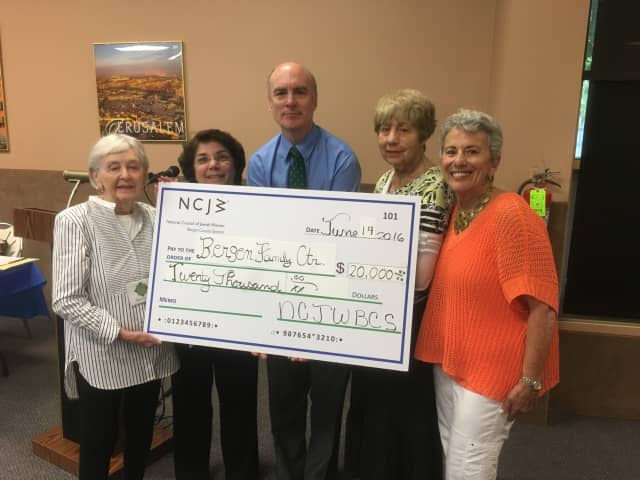 Board members of the National Council of Jewish Women present Mitch Schonfeld, Bergen Family Center CEO, with a $20,000 check to pay for the National Council of Jewish Women/Renee Guller Infant Toddler Center.