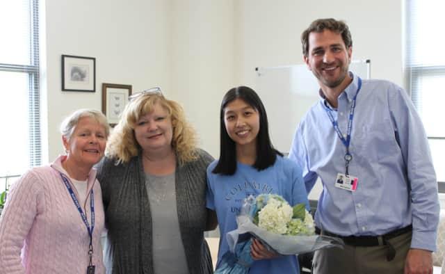 Congratulating Katie Tsui is (from left,) School Counselor Kim Taylor, Darien High School Principal Ellen Dunn, Katie Tsui and Assistant Principal Mike Sullivan.
