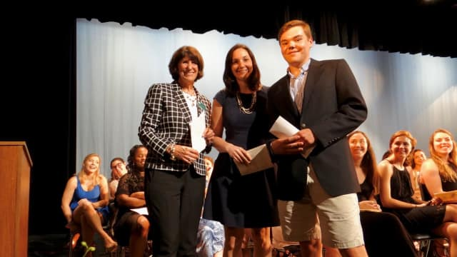 Fairfield Chamber of Commerce President Beverly Balaz, left, and FELO Chair Jackie Kosiba of Delamar Southport, center, present a scholarship to 2017 Fairfield Ludlowe grad Thomas Wyckoff.