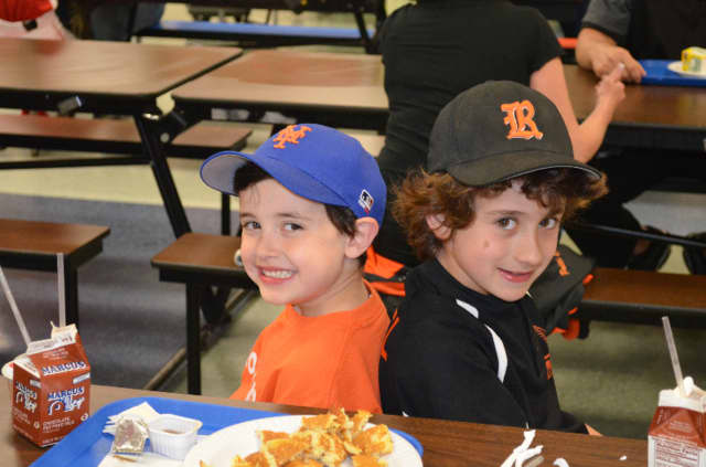 Christopher Bucciero and Owen Zusel enjoy pancakes and chocolate milk at the annual Ridgefield Little League Pancake Breakfast