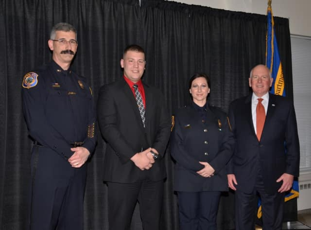 Left to right: Chief of Police Dale Call, Officer Michael Tomanelli, Detective Sharon Russo and First Selectman Jim Marpe.
