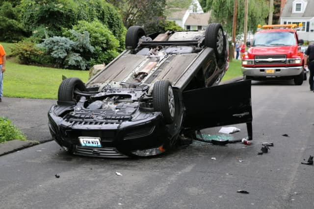 A Nissan Sentra struck a parked car and flipped on its roof on Pemburn Drive Friday afternoon.