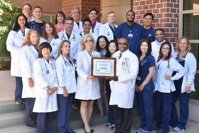 Valley's Respiratory Care department poses, with Bettyann Kempin, Assistant Vice President, Medical/Surgical Services, and Jean-Herve Mondestin, Director, Respiratory Care Services and the Center for Sleep Medicine shown holding the plaque.