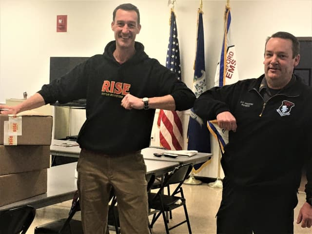 Matt Taylor of RISE (left) delivers care packages to Deputy Chief Ed Podgorski to support Stamford EMS emergency response workers.