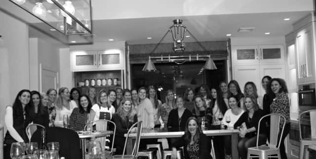 A group of moms from Royle Elementary in Darien kicked off the holiday season with a night at Julia Deane Culinary Works. Chef Julia Deane is featured on the left, wearing a white shirt and Santa apron.