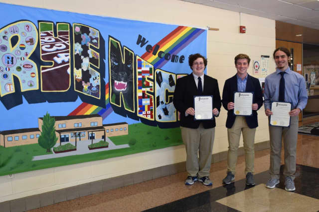 Rye Neck High School students Gabriel Miller, Owen Robertson, and Sean Diamond received proclamation awards for theirresearch on public perceptions of water quality.