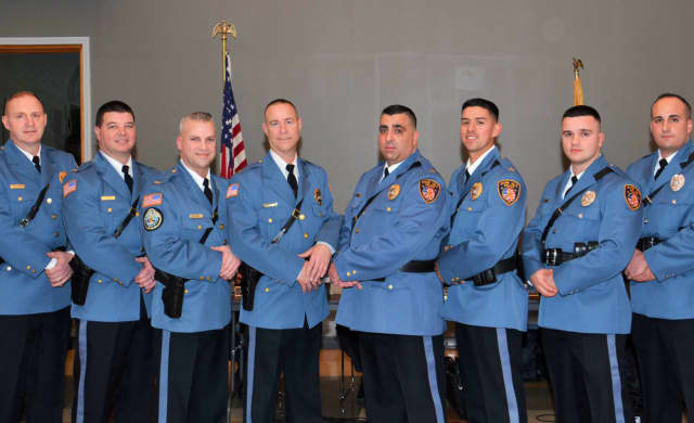 Photo L-R: Capt. Sean Scheidle, Lt. Christopher Bulger, Lt. John DeVoe, Detective Sgt. Peter Martin, Sgt. Dino Dinelli, Sgt. Joshua Wisse and Police Officers Michael Defilippis and Michael Monforte.