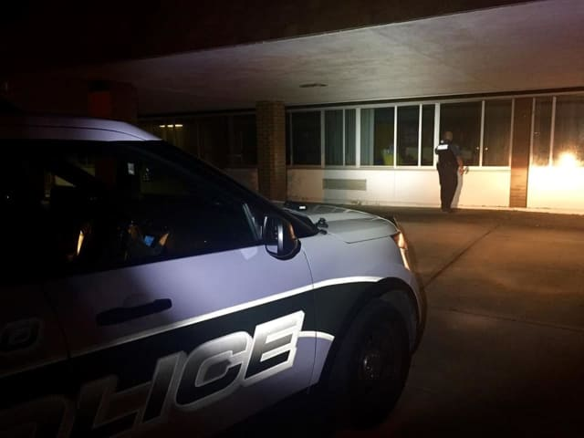 A member of the Ramapo Police Department conducts a security check at an unidentified school in the town recently. So far this year, police have made 381 such checks.