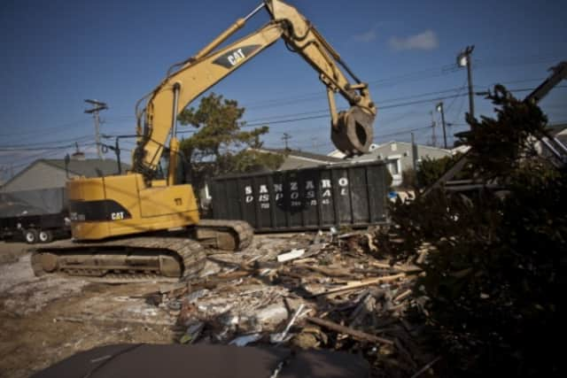 """A so-called """"zombie"""" house in Mount Vernon was torn down Sunday, similar to this demolition."""